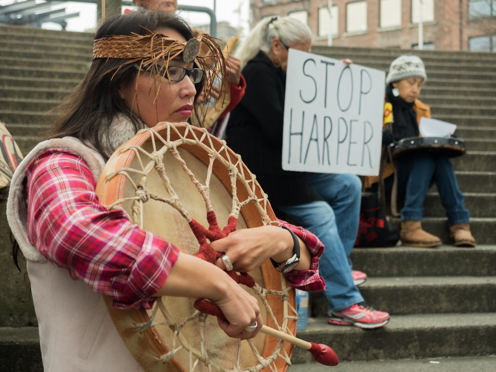 Siegl embraces her buffalo hand drum. Siegl says that re-establishing a connection to her culture saved her from a life of alcohol and abuse.