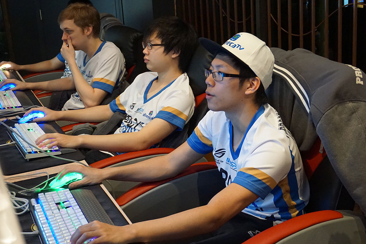 Some of the only times the players get to work together in person are at Internet cafes like this one.