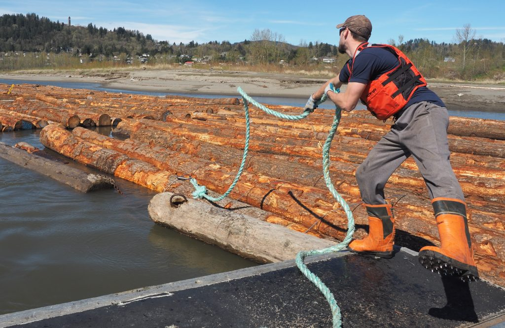 Kuemper unhooks the tow line running to a log boom.