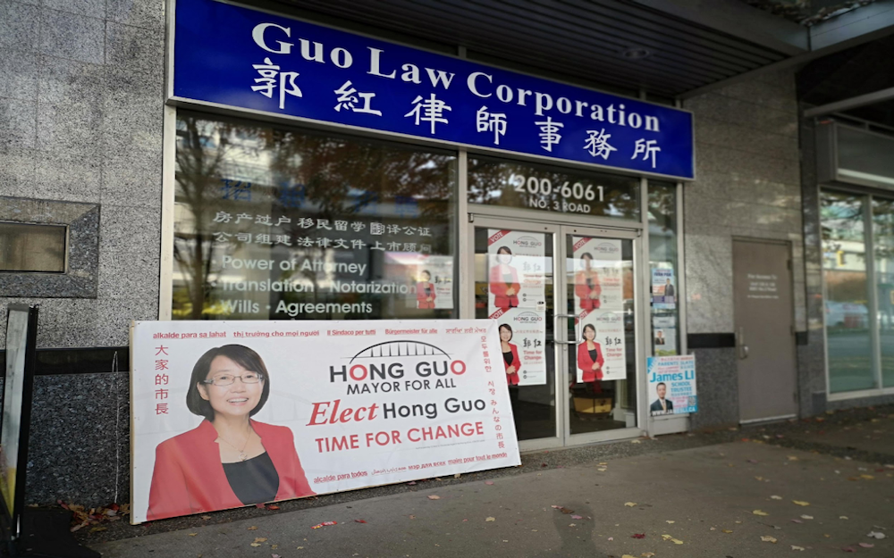Poster outside Guo Law Corporation on No. 3 Road in Richmond